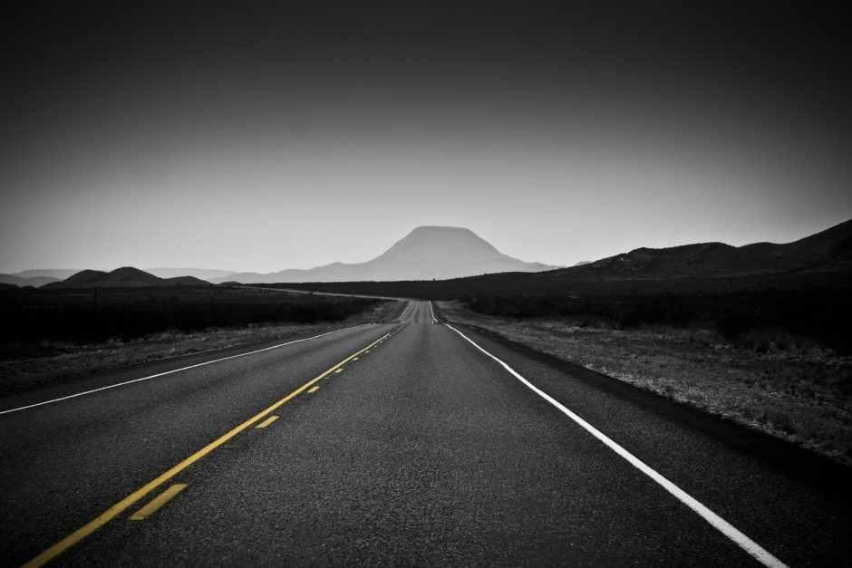 road leading to a mountain