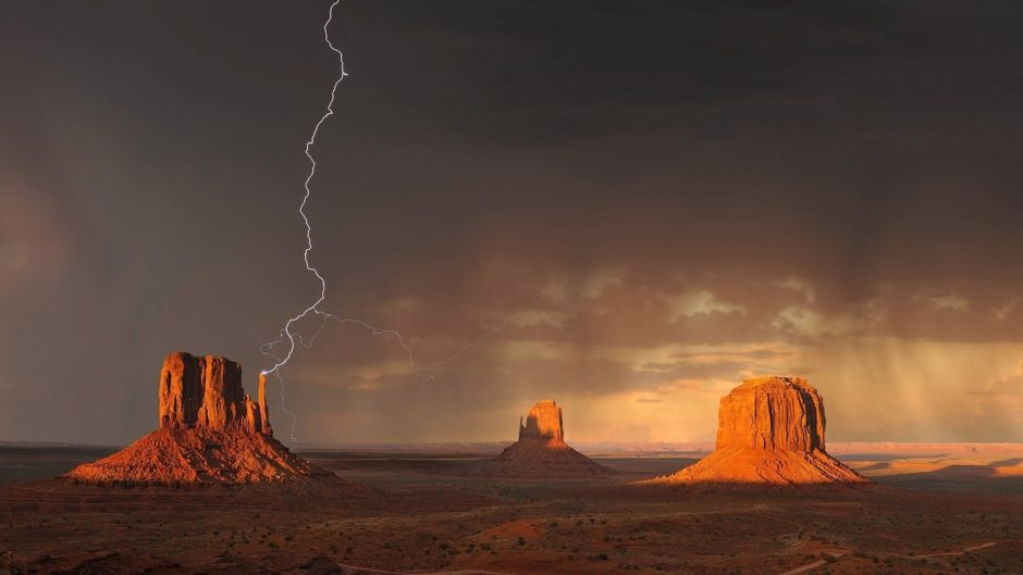Monument Valley lightnin strike on plain in Arizona