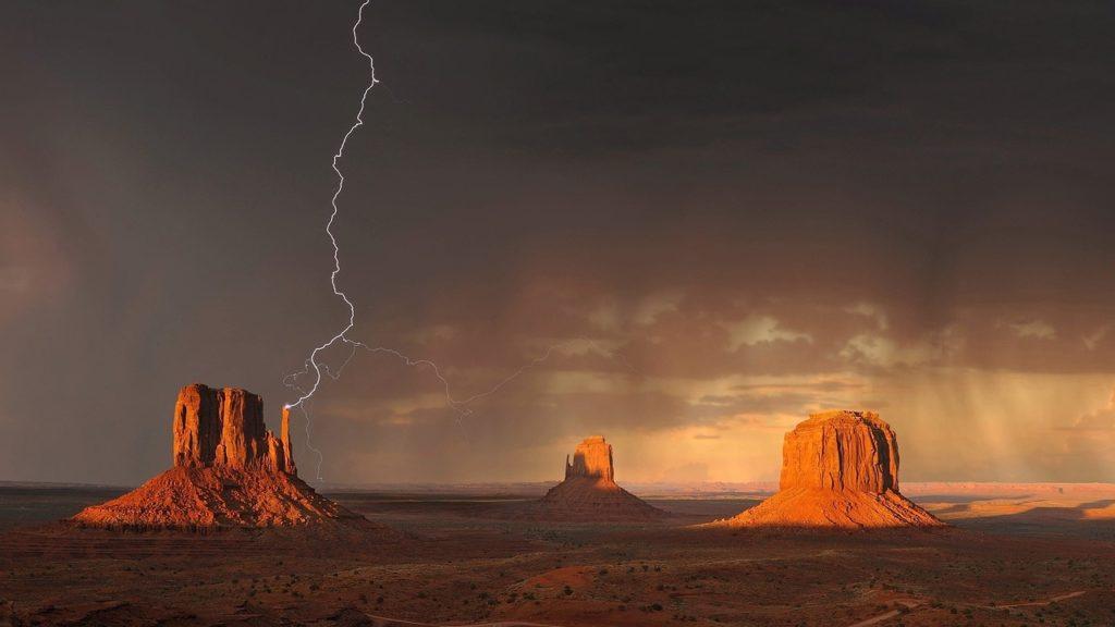 Monument Valley lightnin strike on plain in Arizona