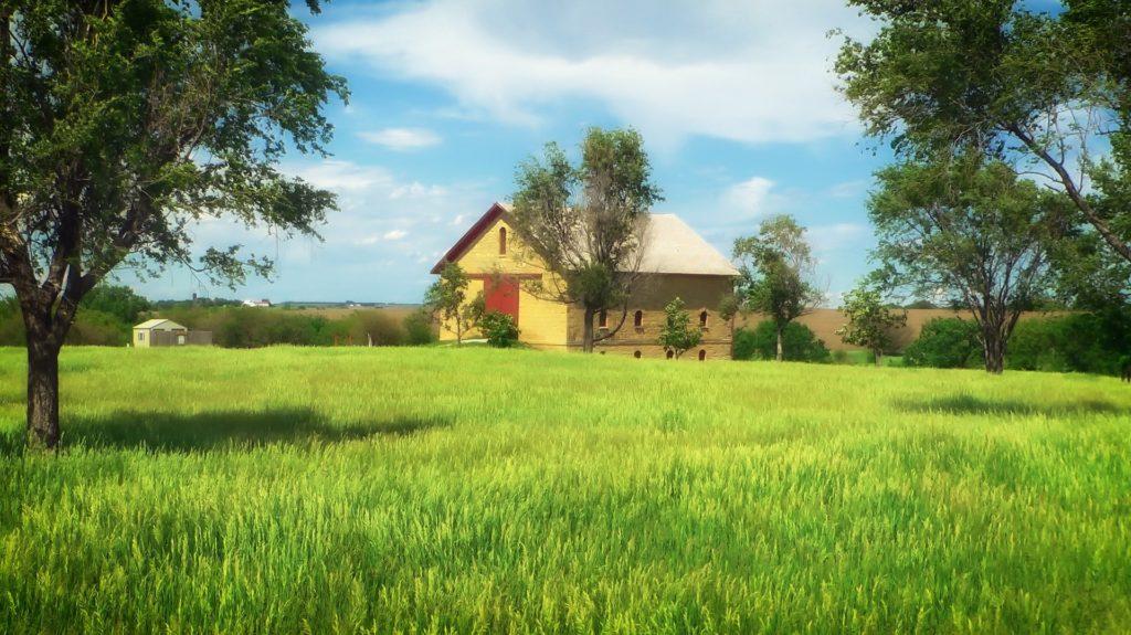 Nebraska, barn sitting in a green field