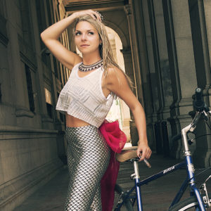Arielle Ditkowich of La Sirena Cigars posing in NYC with a bike