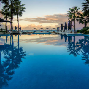 Ganesvoort Dominican Republic resort, pool at sunset overlooking the ocean