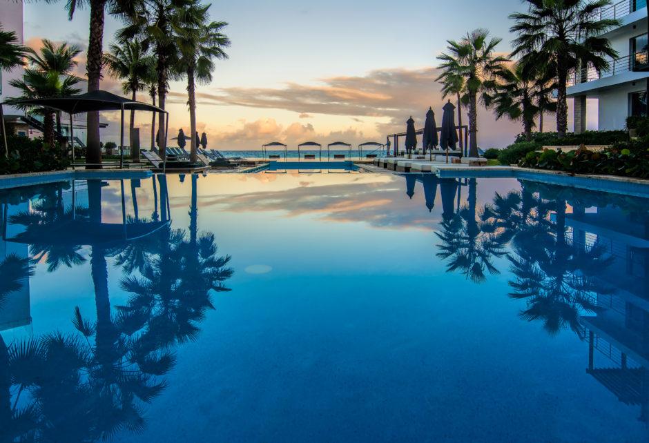Ganesvoort Dominican Republic resort, pool at sunset overlooking the ocean