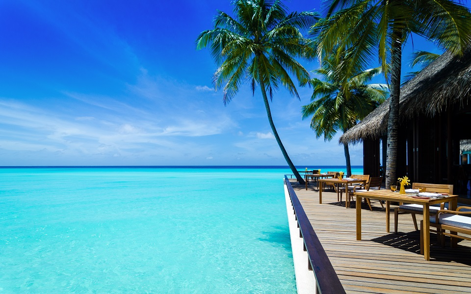 Reethi Rah, Maldives' Luxury Resort, patio and tables overlooking beautiful blue ocean