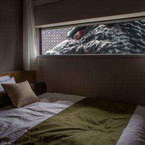 Godzilla-Themed Hotel in Tokyo, godzilla looking into hotel room