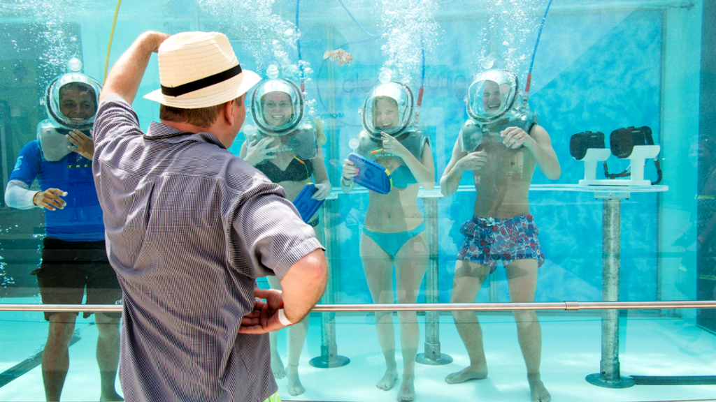 tourists posing in the World's First Underwater Oxygen Bar, Clear Lounge