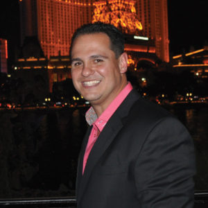 Jason Wood posing in Miami, VP of Miami Cigar