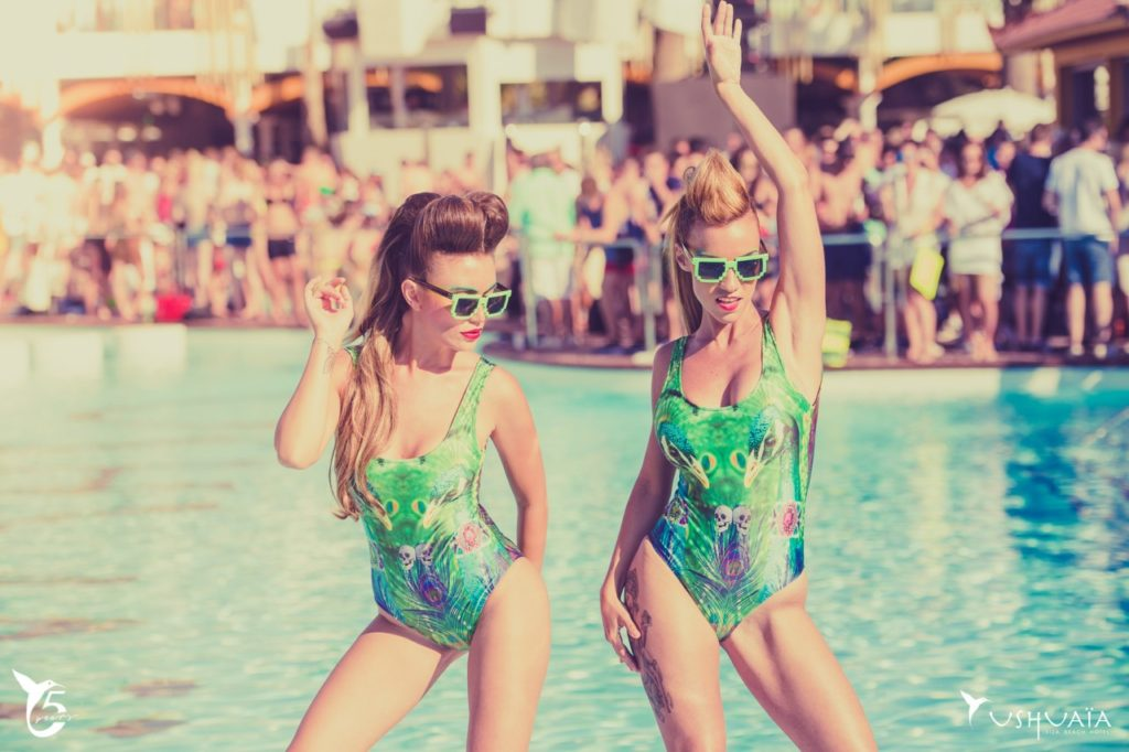 Ushuaiaibiza General in Ibiza, two girls dancing by a pool