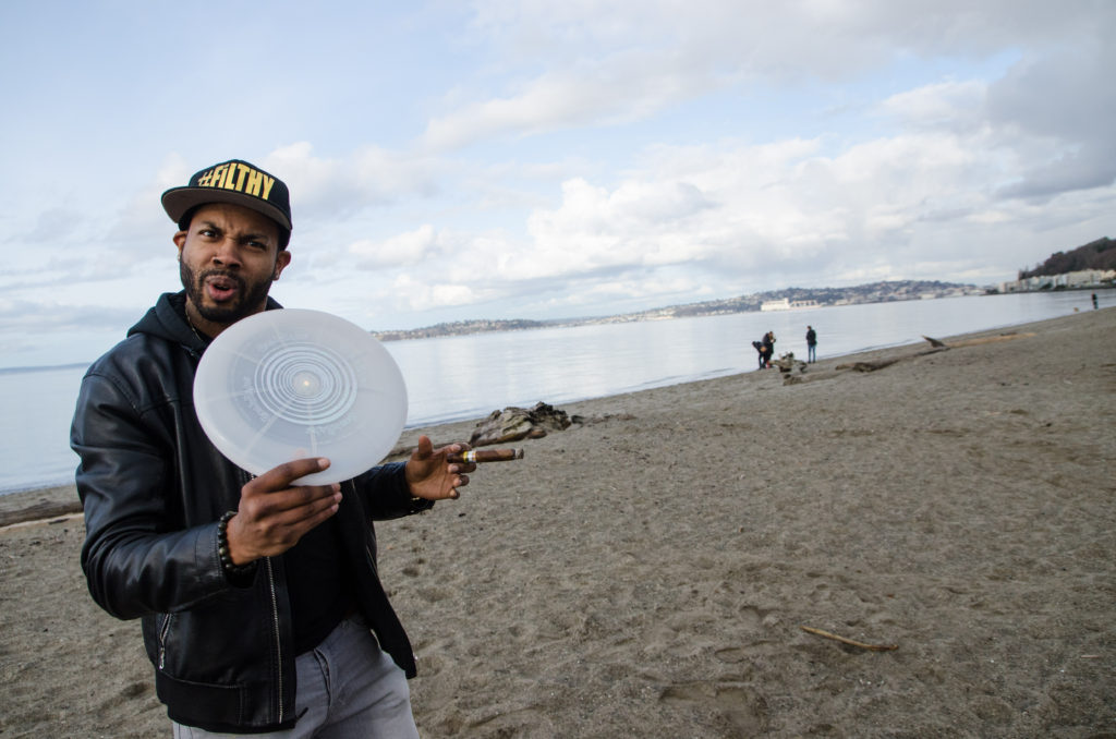 ayron jones in seattle with a frisbee