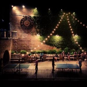 Austin exterior restaurant with patio and lights, easy tiger