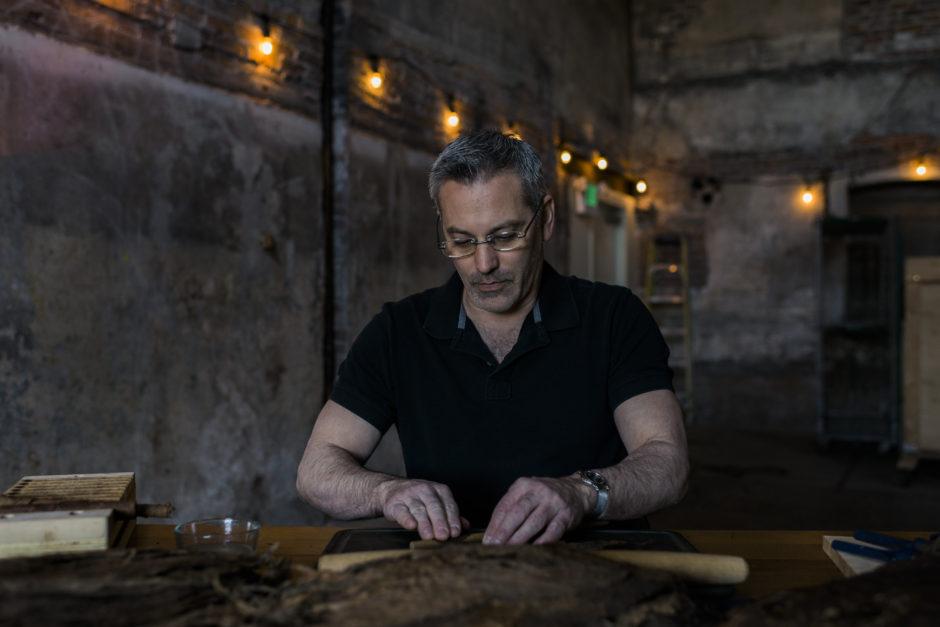Jason of San Juan cigar company in washington, rolling a cigar