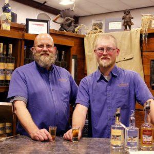 employees posing at sandstone distillery