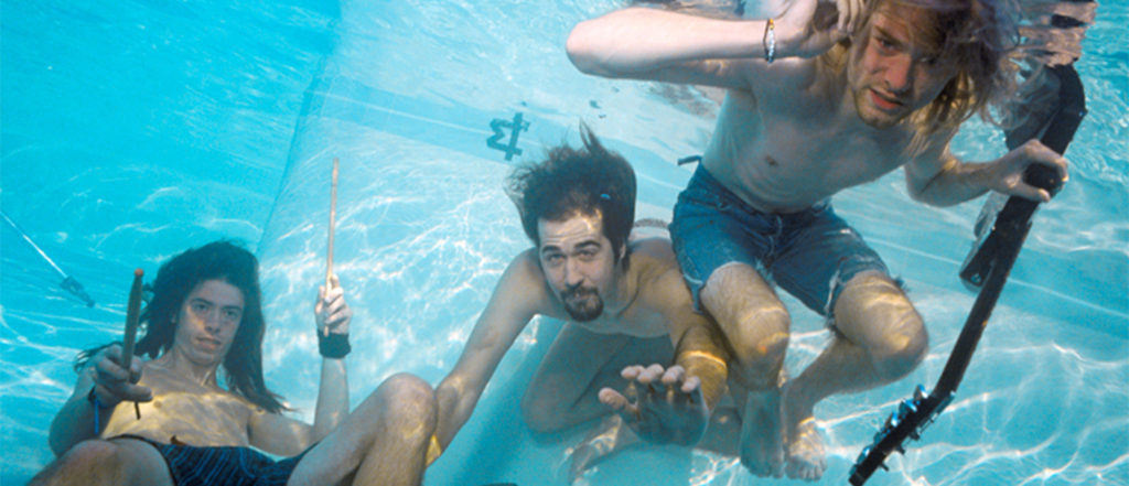 Nirvana underwater in pool with instruments
