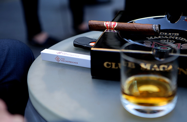 the knickerbocker club macanudo, cigars and drink on table
