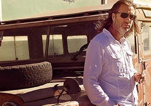 Fred Rewey Nomad Cigar Company by truck with cigar