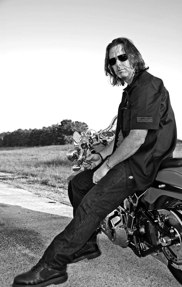 Fred Rewey Nomad Cigar Company on motorcycle with cigar