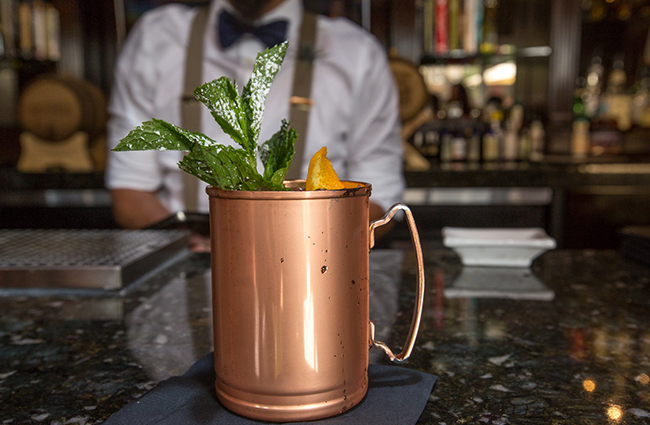oak ivy bar in las vegas, bartender with drink in copper mug
