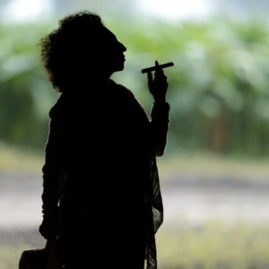 Maya Selva silhouette smoking a cigar