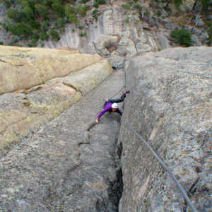 guy climbing devils tower in Wyoming