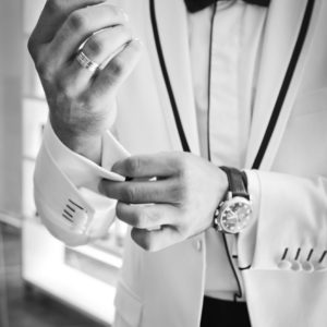 close-up man dressed in suit fixing cuffs