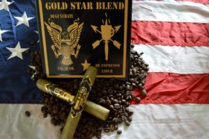 degenerate cigars gold star blend lying on coffee beans and a flag