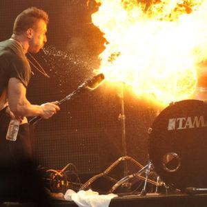 Greg Puciato of Dillinger Escape Plan blows fire during a concert