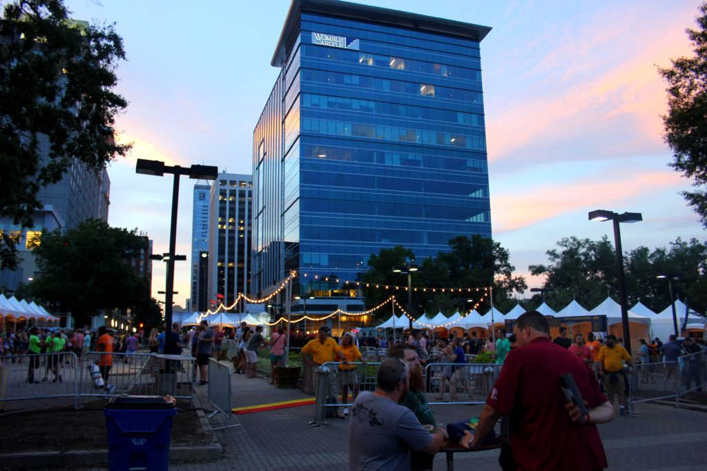 sunset at beer camp in raleigh as people mingle