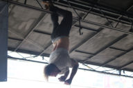 Emarosa hanging from rafters in Dallas for Warped Tour