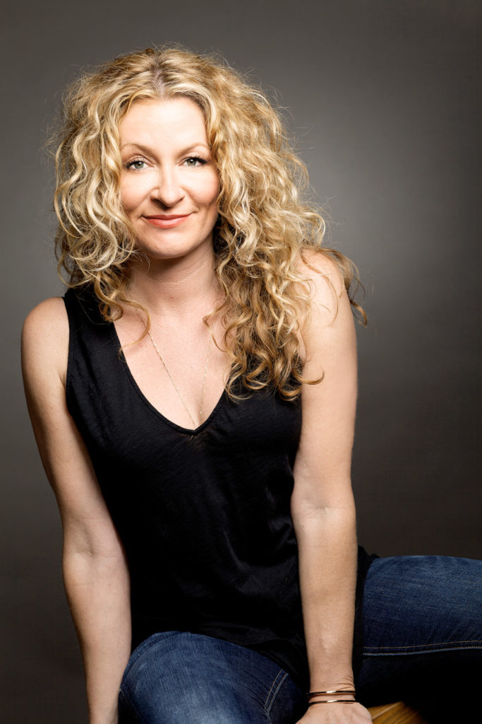 Sarah Colonna in black top and jeans