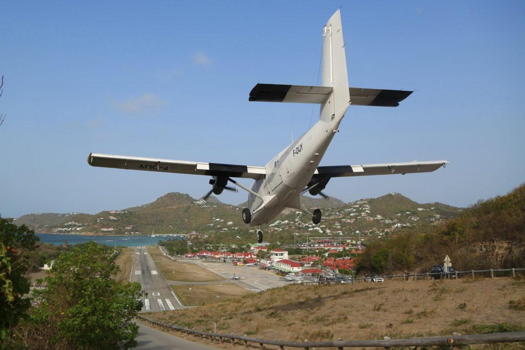 plane landing on steep runway in st. barts