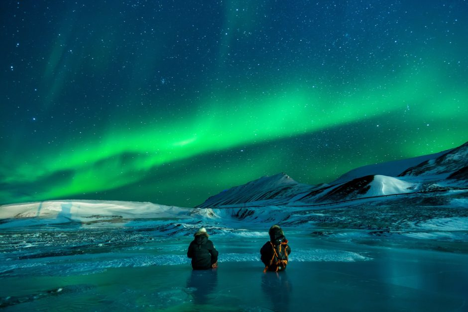 Northern Lights in Alaska with fishermen in the water