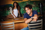 Johnny of Isabela Cigar Company posing with a model in a bar
