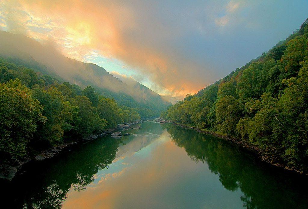 sunrise over river in west virginia