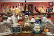 bottles of tequila including Don Julio and Cabo Wabo