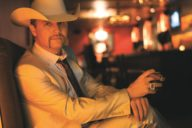 John Rich smoking in suit
