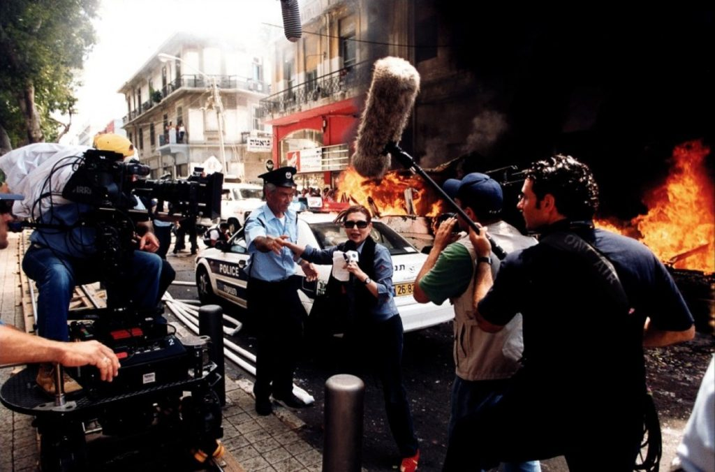 movie extras filming a scene