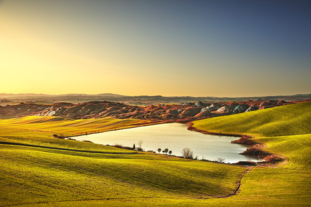 Tuscany, Crete Senesi rural landscape on sunset, Italy. Lake and